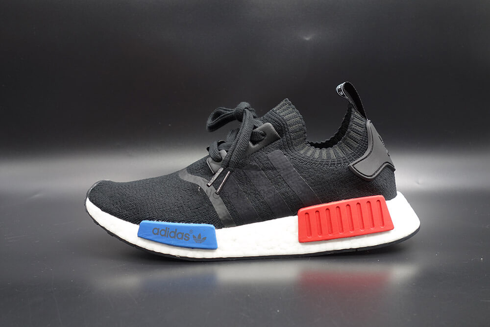3c7464eae It s made of the same materials with the authentic NMD R1 PK Core Black  Lush Red